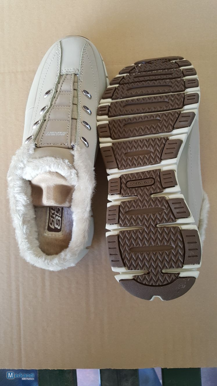 huge selection of 170e9 06658 Lotto scarpe marche: Skechers and Daddy's Money | Stock ...